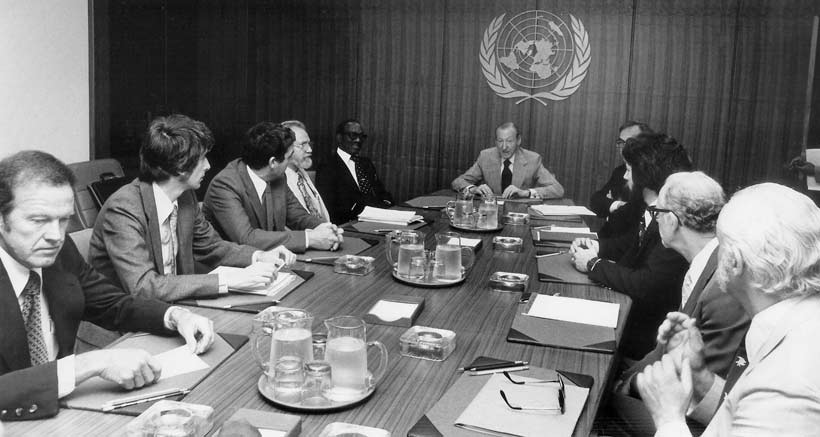 Clockwise from left: astronaut Gordon Cooper, astronomer Jacques Vallee, astronomer/astrophysicist Claude Poher, astronomer J. Allen Hynek, Grenada Prime Minister Sir Eric Gairy, UN Secretary-General Kurt Waldheim, Morton Gleisner of the Special Political Committee, Lee Speigel, researcher Len Stringfield, and University of Colorado psychologist David Saunders